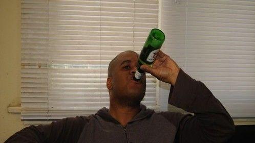 Simon drinks a beer.
