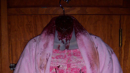 A headless zombie costume I made to wear later this year. It is rigged to squirt blood out of the neck.