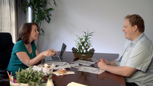 """Susan (Kristin Maloney) meets with Caskey (Caskey Hunsader) to discuss a job opportunity in episode 1 of """"Fat Guy"""""""