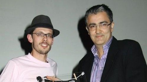 """Receiving the bronze award from Giacun Caduff in Los Angeles for """"Utopia Lies at the Horizon"""""""