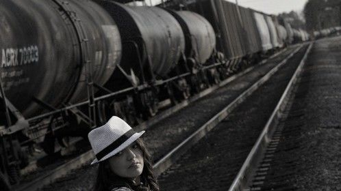 """""""Runaway"""" Model Mia Brown posing on tracks with instrument"""