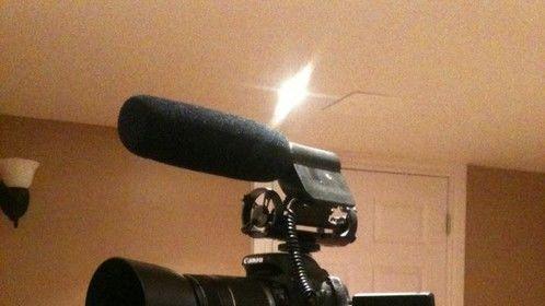 Canon T3i with Beachtek DXA 5DA, 55-250 mm lens with ET-60 lens hood,Rode Videomic,Sony Headphones, and a Velbon tripod