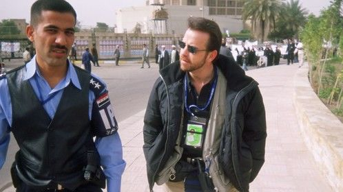 Interviewing the only police officer assigned to hold back a crowd that was growing behind us every minute. Fardos Square, Baghdad - 2004 (The History Channel)
