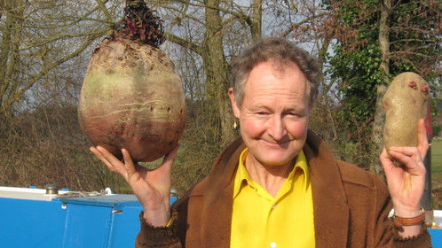 Biggest beetroot in the world, grown by me at my allotment 2012. Plus a pretty big tattie (potato) as well. My boat on Oxford canal behind me.
