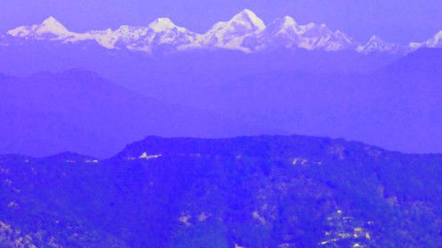 View of himalayas above the valley