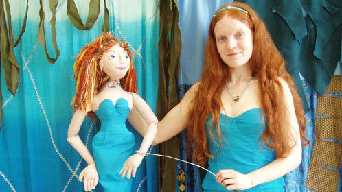 Playing The Little Mermaid in a theatre tour (puppeteer of mermaid and myself when she turns into a human )