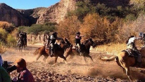 "Actor Terry Silverthorne, center screen, gallops through a dry river bed in an episode of ""Dead Men the series"" on screen in 2015!"