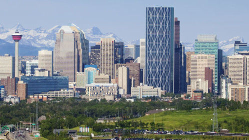 Calgary. Really great mountains, vast, rolling prairies, big city with a small town attitude. Not much for lakes...