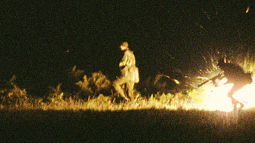 It's 4am, pitch black, we're on our stomachs trying to hide from a parachute flare. The flare dies away, it's dark again when...all hell breaks loose, explosions, machine gun fire, tracer rounds from the right and battle-cry from the left. I'm up and running when I go arse over tit as I hit barbed wire. Picking myself up, and by feel alone, I set my camera to infinity, 1/30th and wide open. With the motor-drive on I raise the camera above me, point it at nothing and fire a burst of 36 exposures, then I hit the deck. A few days later in the lab' this totally black roll of 35mm transparency film emerges, with just ONE frame exposed... lit only by an explosion set off as a soldier went through a trip wire. What are the odds?