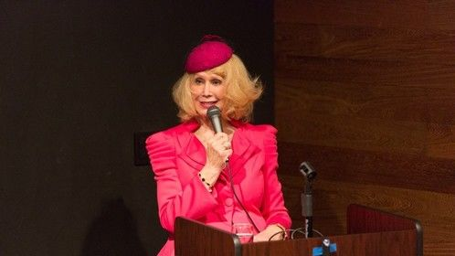"I wear 1940's clothing when I introduce my film ""Echoes of World War II"" at a screening even."