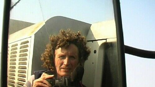 Self-portrait in the mirror of a combine, while filming the hemp harvest in Noirmoutier, France