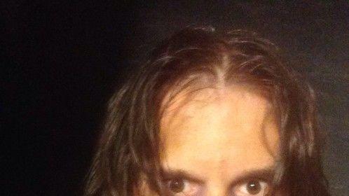 Me in makeup and costume as a voyeuristic serial killer in a trailer for Asgard Film Studios in San Antonio, Texas