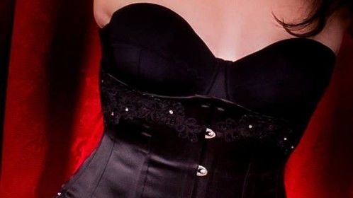 Black underbust corset made to measure for burlesque performer LadyK Phoenix of The Scarlet Vixens.