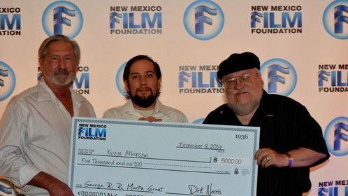 Screenwriting Grant winner Kevin Atkinson receives check from George R.R. Martin and Dirk Norris, executive director of New Mexico Film Foundation
