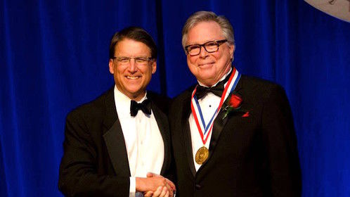 Ira David Wood III receiving the NC Award, the highest civilian award presented by the State of North Carolina on November 13, 2014.  Mr. Wood is pictured with NC Governor, Pat McCrory