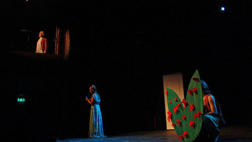 From our 2013 original production of Carnival Tale (Tivolisaga), a musical loosely inspired by Shakespeare's Romeo and Juliet.  Arbisteatern, Norrköping, Sweden.  A love trio - Judy (Linnéa Källström) reads the letter from her secret admirer Punch, a carnival jester (Olle Petersson, hiding), believing it's from the rich gentleman Valentin (Johan Ivarson, top left).