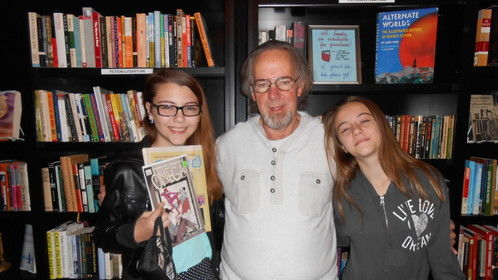 Having fun at a book signing in Nov, 2014 at The Book End located inside The Phoenix in Tulsa with granddaughters Sable (L-14) and Breandra (R-11). I'm the old guy in the middle.