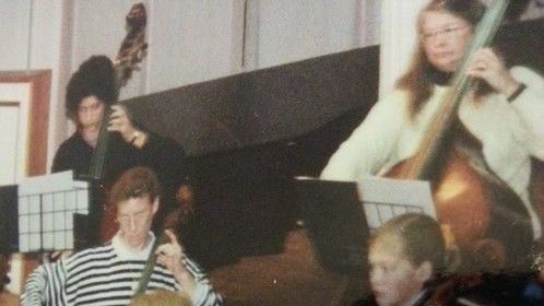 Rosamund Pike and I playing 'cello in school orchestra.  Our taste in sweaters has greatly improved with age (as have our looks).  I stuck with the music career .....  she earns a lot more than me ....  :-)