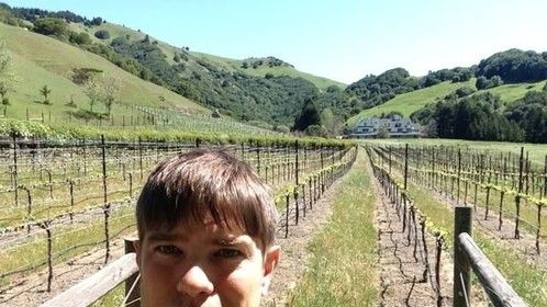 PJ Corvus at Skywalker Ranch. Taking a break from being inside the tech building for hours, its great to get outside and walk around on my lunch break. Behind me you can see the Main House and some of the grape vineyards