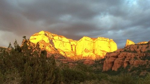 Jumped out of the car when I saw the late sun hitting these red rocks turning them golden, after an incredible hike high up into Petroglyph heaven. One of those incredible magical moments. Literally only a minute or so and it was gone.
