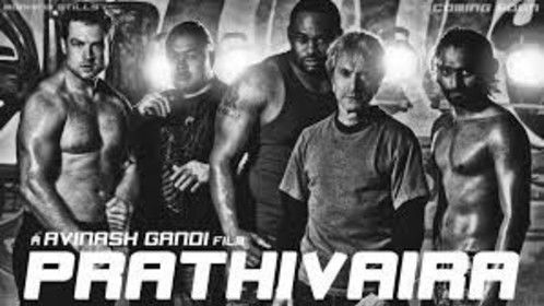 "On set photo of Fight Action's stunt fighter team posing with lead actor Prim for the film ""Prathivaira."" From Left: Curt Cotton, Charles Maxwell (deceased), Big Spence, Durand Garcia, Prim. Not shown: Daniel Hernandez."