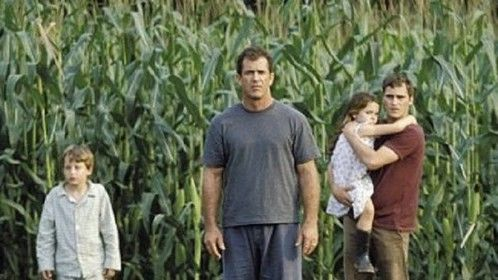 Signs (2002)  Dir: M. Night Shyamalan Stars: Mel Gibson, Joaquin Phoenix, Rory Culkin, Abigail Breslin  A family that lives on a farm finds weird and mysterious crop circles in their fields, which could be a sign that something frightening is about to come.  Watch it here: http://www.primewire.ag/watch-1303-Signs-online-free