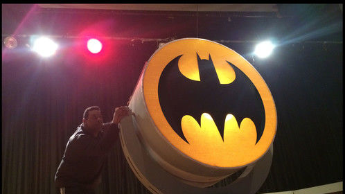 "Behind the Scenes :  ""FATHERS OF THE DARK KNIGHT"", Roberto Williams Playwright, Producer, & Director.  LION'S ROAR ENTERTAINMENT 2014 Williams tests the functions of the 8 foot tall BATSIGNAL stage prop."