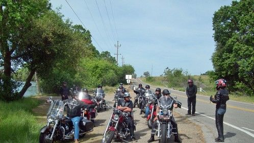 Lisa Rentuor (at right), the lead female part of Jill Arnold in Ride to Iron Mountain, gives instructions to the team before our road trailer shoot.