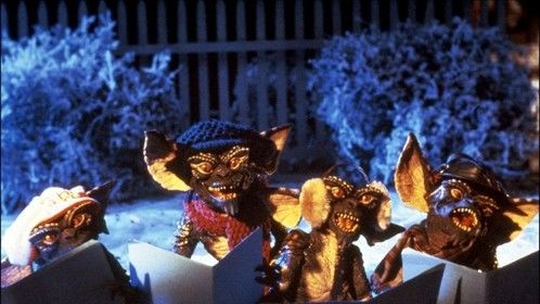 Gremlins (1984)  Dir: Joe Dante Stars: Zach Galligan, Phoebe Cates, Hoyt Axton  A boy inadvertantly breaks 3 important rules concerning his new pet and unleashes a horde of malevolently mischievous monsters on a small town.  Watch it here: http://www.primewire.ag/watch-1595-Gremlins-online-free