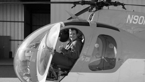 Flying a MD-500 (Hughes 369) series helicopter.