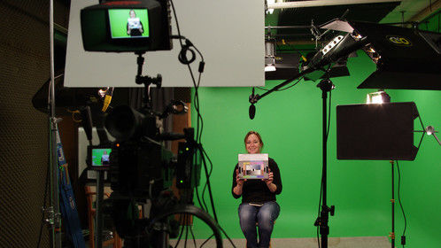 Lighting setup in a green screen studio for a client shoot, with assistant Mica Rausch.