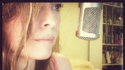 "Sharee Anne Gorman (annienomad~cyberpoet) recording ""Truce - A Poem For Children of War""."""
