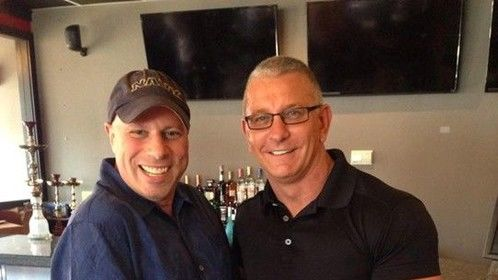 Steve Okrepky on set of Restaurant Impossible with Chef Robert Irvine.  His muscles are puny compared to mine ;)