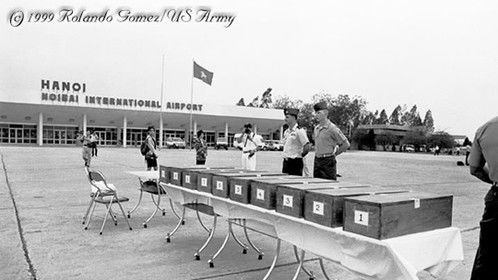 Photo of ten sets of military member remains being returned to the U.S. military Joint Task Force Full Accounting, taken just before the 20th anniversary of the Fall of Saigon in April 1995.