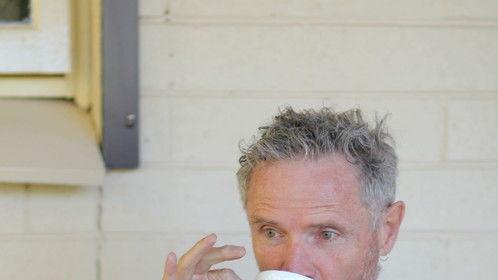 Mr Nicholas sips tea