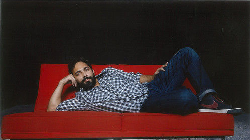 I can also strike a prone pose on a red couch like a boss
