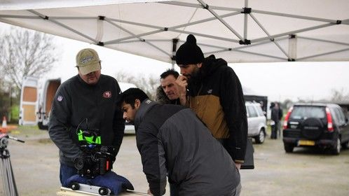Reviewing a shot on the set of Game over with Director Adam Jenkins (R) and Cinematographers Werner Van Peppen and Sundeep Reddy (L)