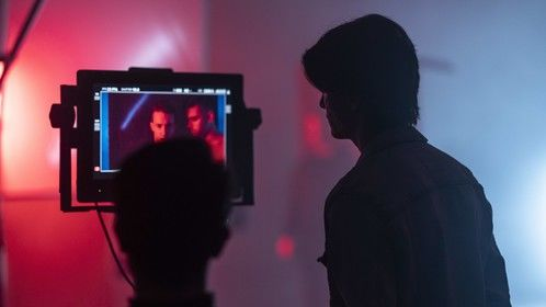 """Director Nicolas Wendl and DP Sten Olson on the set of Parker Matthews' """"Running From Me"""" music video in February 2019."""
