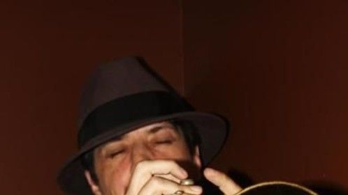 Brian M. Wixson playing the trumpet