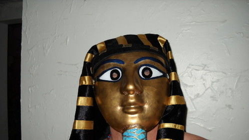 Pharaoh's funerary mask I made.  Mask is pressed paper-pulp, false-beard is fiberglass and wood, eyes are made of acrylic.