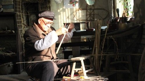 A still from the film. This is a master kite maker.