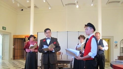The costumes for this Readers Theatre of O Henry's story were B&W w/ red.