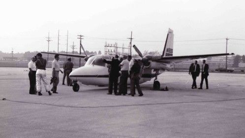 Picture of 58 November on the ramp at Jacksonville International after the Fatal Hijacking. FBI Agents surround the plane looking over crime scene.