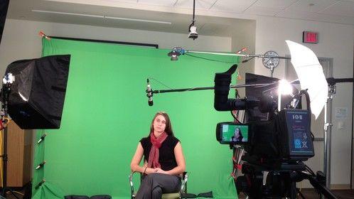 A green screen setup for an internal bank video