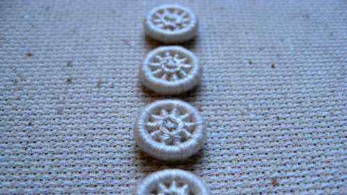 Small (approx 1.5cm) dorset buttons in ecru, lace pattern.