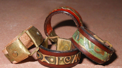 Leather rings with embossed metal