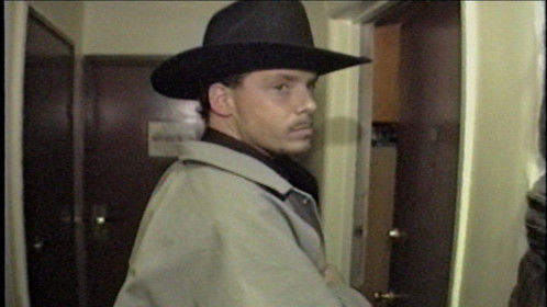 Ma as Jack Dalton being cautious before entering suspects apartment.