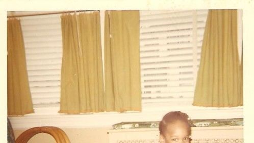 Me age 3. Cute as hell but U know I was the lil terror in the house!!! LOL