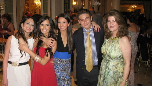 At a party celebrating Persian New Year (these are nieces and nephew); I'm on the far right in the greenish dress.