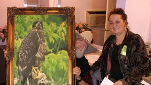 Lisa Loucks Christenson (Lisa's Bald Eagle Documentary™), presenting Charlie Daniels the eagle named for him, Daniels Charlie.